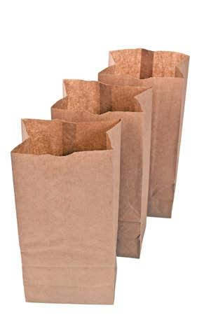 thrifty: Three Brown Lunch Bags Standing In A Row