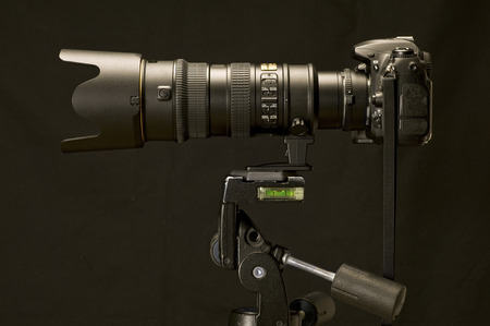 optical instrument: Digital Camera And Zoom Lens On Tripod Stock Photo