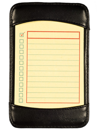 pocketbook: Yellow To Do List In Black Leather Folio Stock Photo