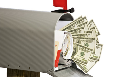 Money In Your Mailbox On White Background photo