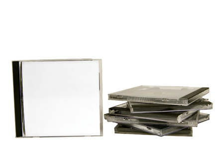 dvdrw: Blank White CD Case With Stack Of CD Cases