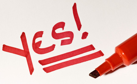 positivist: The Positive Word YES Written In Red With Marker Stock Photo