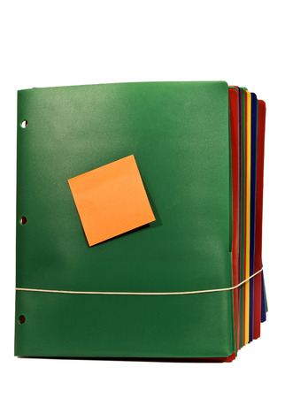 databank: Bundle Of Folders With Blank Sticky Note On Front Stock Photo