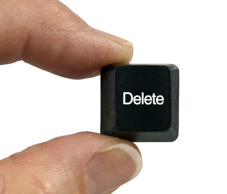 thumb keys: Fingers Holding Black Delete Key On White Background