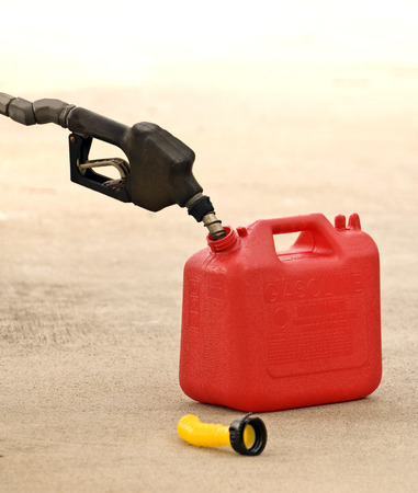 gas nozzle: Black Gas Nozzle Putting Gas Into Container