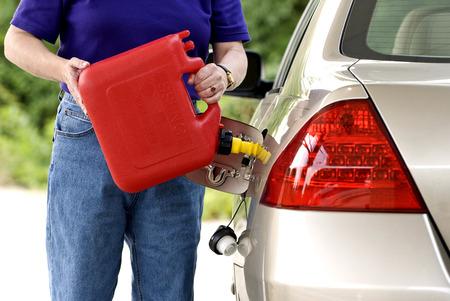car gas: Adding Gasoline To Car Gas Tank