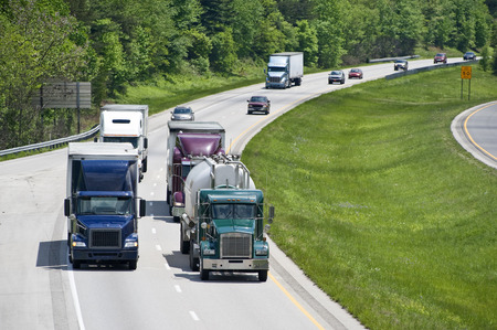 scenic highway: Scenic Highway With Diesel Trucks And Traffic Stock Photo