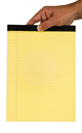 Hand Holding Blank Yellow Pad