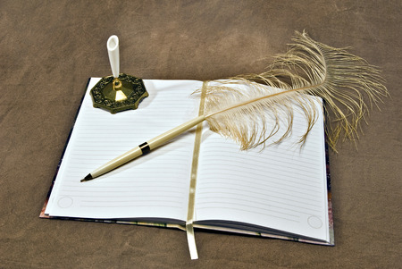 feathered: Blank Journal Opened With Feathered Pen Stock Photo