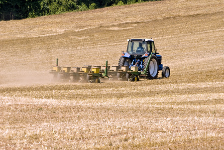 farm implement: Tractor Seeding Field For Summer Crops