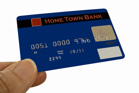 fictitious: Hand Presenting Fictitious Debit Card Or Making A Purchase Stock Photo