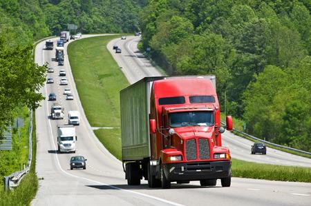 oversize load: Red Semi Truck Climbing Hill