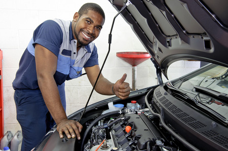 african american: Handsome Confident Mechanic Smiling And Giving A Thumbs Up