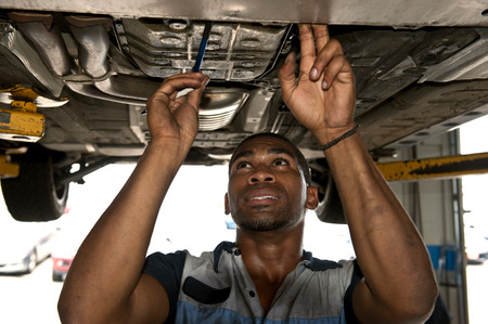 african american: Cute Confident Mechanic Looking Over Vehicle