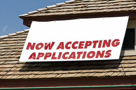 accepting: NOW ACCEPTING APPLICATIONS Sign On Rooftop Of Business