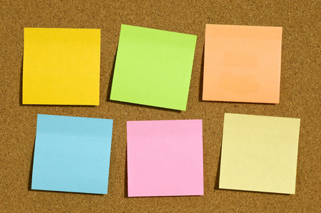 Different Colors Of Sticky Notes On Bulletin Board photo