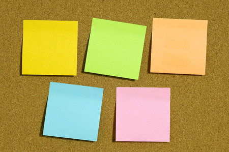 yellow tacks: Sticky Notes Of Different Colors On Cork Board Stock Photo