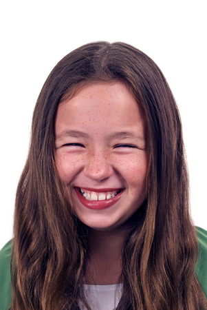 giggling: Portrait Of Little Girl Laughing And Giggling On White Background Stock Photo