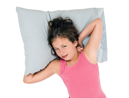 laying down: Little Girl Waking Up And Smiling On Her Pillow Stock Photo
