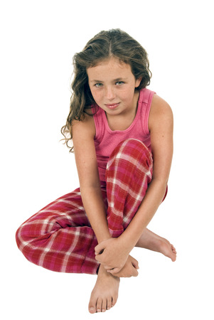 8 year old girl: Portrait Of Little Girl Sitting Smiling On White Background Stock Photo