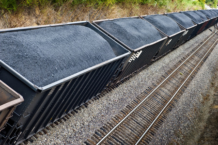 laden: Line Of Coal Freight Cars Full On Train Track