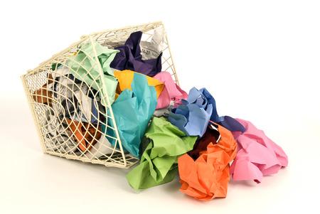 wastebasket: Metal Wastebasket Spilling Out Colorful Trash