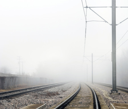 Train Tracks Disappearing Into Fog Horizontal Shot