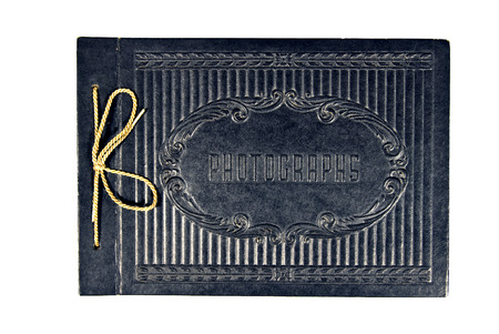 photo album book: Vintage Or Antique Photo Album With Gold String Tied Bow Stock Photo