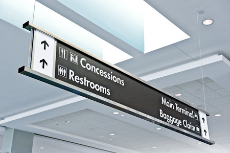 airport sign: Airport Sign Showing Directions And Baggage Claim