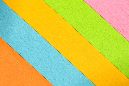 slanted: Slanted Multi-Colored Stacks Of Paper Background