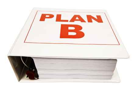 business symbols metaphors: Bold Red Letters On Book Showing PLAN B