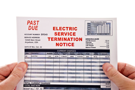 utility payments: Hands Holding Electricity Service Past Due Bill On White Background