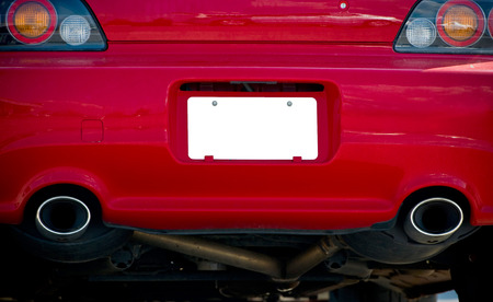 Blank License Plate On Red Sports Car Stock Photo