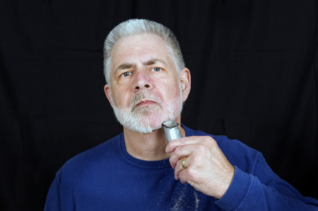 Old Guy Having To Shave Beard  For New Job Stock Photo