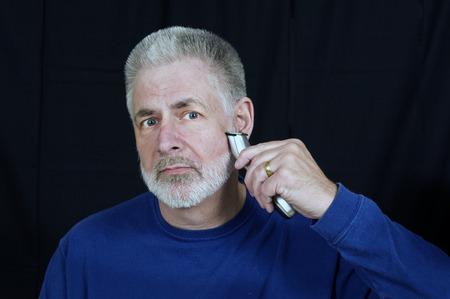 nicked: Afeitarse la barba para el nuevo empleo Foto de archivo