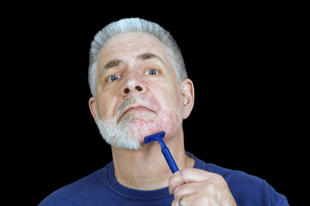多くの刻み目とカットとひげを剃っ 写真素材