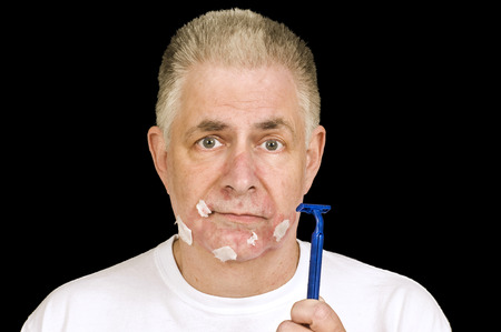 Old Man With A Bad Shave Nicks and Cuts Stock Photo