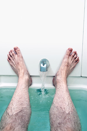 drenched: Running Water In Tub With Man Relaxing