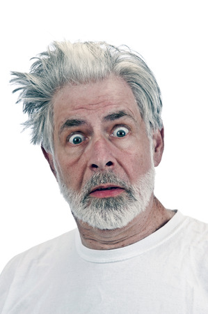 only one man: Close Up Portrait Of Frightened Or Surprised Old Man Stock Photo