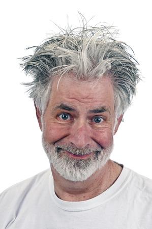 smug: Portrait of Grinning Simpled Minded Old Man