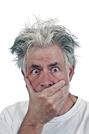 Portrait Of Surprised Old Man Hand Over Mouth Stock Photo