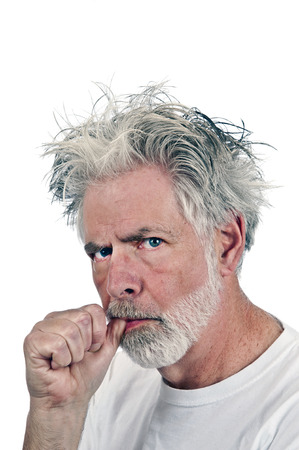 clueless: Portrait Of Confused Man Sucking Thumb Stock Photo