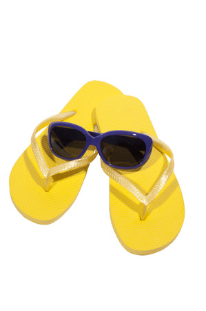 thongs: Yellow Thongs or Flip Flops With Sunglasses Isolated Stock Photo