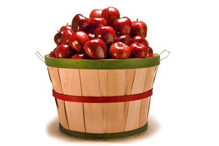 Large Bushel Basket Of Red Apples Lit Overhead with Shadow Around Base