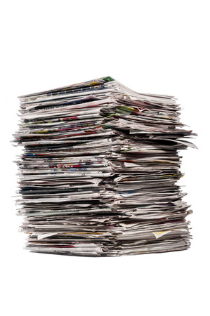 Tall Stack Of Newspapers On White Background Banque d'images