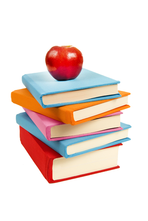 unevenly: Books Stacked Unevenly With Apple