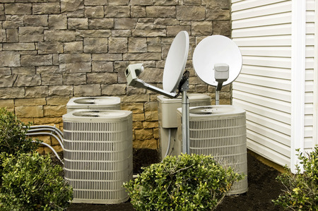 units: Air Conditioning Units And Satellite Dishes Stock Photo
