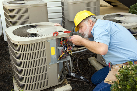 maintenance man: Working On Air Conditioning Unit