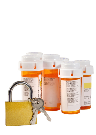 Lock Up Your Medication Narcotics Selective Focus On Lock With Bottles Out Of Focus
