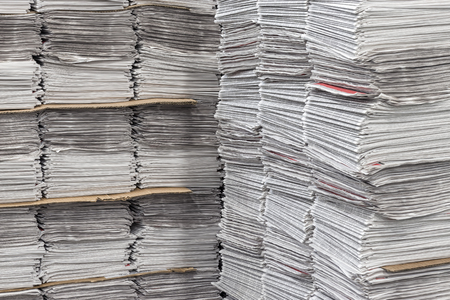 data distribution: Stacked Bundles Of Newspapers Stock Photo